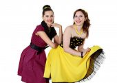 image of poodle skirt  - two stylish young woman in bright colour dresses - JPG