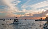Fishermans Sunrise View Of Fishing Boat Going Out For The Day Past Lands End In Cabo San Lucas In Ba poster