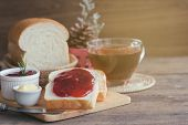 Delicious Toast Bread With Butter And Spread With Strawberry Jam. Homemade Bread And Jam Served With poster