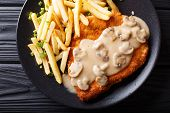 Crispy Fried Pork Chops (jaeger Schnitzel) With Sauce And French Fries Close-up. Horizontal Top View poster