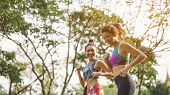Two athletic woman running outdoors. Action and healthy lifestyle concept.Jogging run in park poster