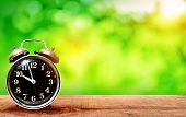 Retro Clock On Wooden With Nature Green Bokeh Background On A Light Green - Dark Green poster