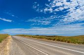 Rural Road On Sunny Day. Outback, Countryside Infrastructure Background poster