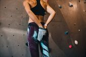 Woman Wall Climber Coating Hands With Gripping Powder poster