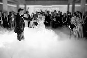Beautiful Bride And Handsome Groom Dancing First Dance At The Wedding Party. poster
