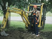 Sexy Man With Nude Torso Near Construction Equipment Or Excavator On Background. Sexy Builder Concep poster