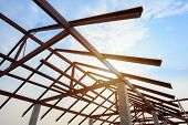 Structure Of Steel Roof Frame For Building Construction On Sky Background. poster
