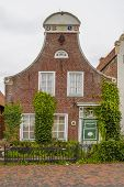 Idyllic Traditional House Facade In Greetsiel, A Idyllic Village Located In East Frisia, Northern Ge poster