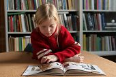 foto of girl reading book  - a little girl reading a book - JPG