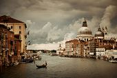 Venice  Church Santa Maria della Salute and canal in an overcast day. Italy. poster