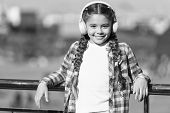 Enjoying Her Favorite Music. Little Girl Wearing Stereo Headphones. Little Girl Listening To Music.  poster