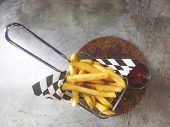 French Fries In A Cardboard Scoop.french Fries In Basket With Ketchup And Sauce Isolated On Rustic G poster