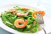 stock photo of snow peas  - Salt and pepper shrimp with snow peas - JPG