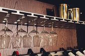Closeup Many Upside Down Empty Clear Transparent Crystal Upturned Wine Glasses Hanging In Straight R poster