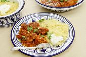 stock photo of tagine  - A meal of chicken tagine stew in a spicy - JPG