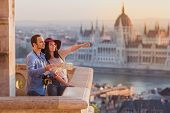 Young Couple Searching Right Direction On Map From The Point From Fisherman Bastion In Budapest With poster