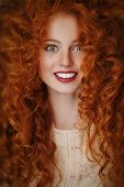 Beautiful smiling girl with long red hair. Hair care, hair coloring. Copy space. poster