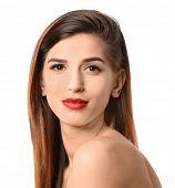 Attractive young woman with elegant makeup and long eyelashes on white background. Eyelash extension poster