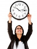Business woman hanging a clock �?�¢?? isolated over a white background