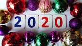 New 2020 Year. The Numbers 2020 Are Red And Blue Between Multi-colored Glass Christmas Balls. Glimme poster