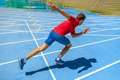 Runner athlete starting running at start of run track on blue running tracks at outdoor athletics an poster