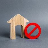 Wooden House Figurine And A Red Prohibition Symbol No. Concept Of Inaccessibility Or Lack Of Housing poster