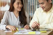 Asian Couples Are Calculating Income And Expenses To Cut Unnecessary Expenses And Planning To Borrow poster