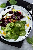 Foie Gras With Berry Sauce And Greens On A Black Tablecloth On The Grey Background poster