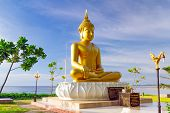 PHANG NGA, THAILAND - NOV 15: Statue of golden Buddha Buddha that sits back to the sea and directly
