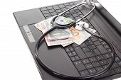 image of lobbyist  - Stethoscope and money lying on the keyboard - JPG