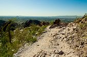 stock photo of piestewa  - Trail Leading over a Sharp Cliff Looking out to Phoenix Arizona - JPG