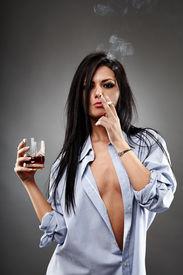 foto of debauchery  - Sensual young woman in a man - JPG