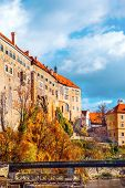 Autumn view on the Cesky Krumlov Castle and a bridge over Vltava river