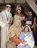 Live Christmas nativity scene reenacted in a medieval barn