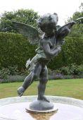 stock photo of ero  - Garden Eros fountain on pedestal spurting water - JPG