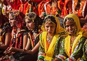 PUSHKAR, INDIA - NOVEMBER 21, 2012: Unidentified Rajasthani girls in traditional outfits prepare for
