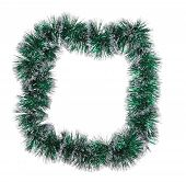 Christmas green tinsel as frame.