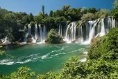 stock photo of yugoslavia  - The Kravica waterfalls in Bosnia and Herzegovina - JPG