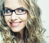 image of nerd glasses  - calm and friendly blond woman with glasses - JPG