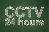Privacy concept: CCTV 24 hours on chalkboard background