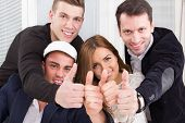 Casual Group Of Successful People Make The Ok Thumbs Up Sign