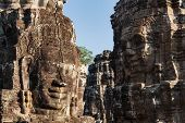 ANGKOR THOM, CAMBODIA - DECEMBER 23, 2013: Ancient stone faces of Bayon temple, Angkor, Cambodia