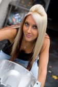 picture of crotch-rocket  - A young woman seated on a motorcycle - JPG