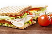 image of nic  - Sandwiches with chicken breast salad cheese and tomatoes on wooden table - JPG