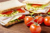 picture of nic  - delicious sandwiches with chicken breast salad cheese and tomatoes - JPG