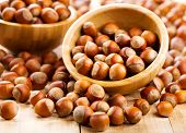 pic of hazelnut  - a fresh hazelnuts on a wooden table - JPG