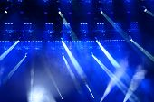 foto of soffit  - Illuminated empty concert stage with smoke and rays of light - JPG