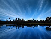 Angkor Wat Cambodia. Ancient temple at  sunset. Beautiful sky and lake reflection.