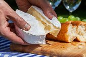 Hands With Camembert Cheese