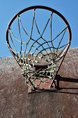 picture of netball  - closeup of old basketball backboard and hoop outdoor - JPG